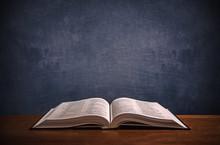Open Bible On A Wood Desk