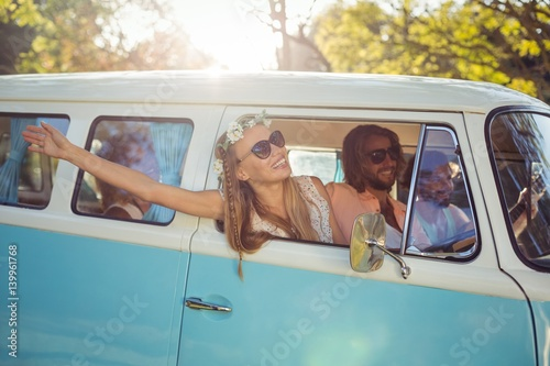 Photo  Woman looking out of campervan window