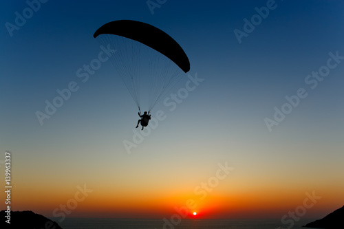 Canvas Prints Sky sports Paraglider silhouette against the background of the sunset sky