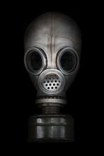 Old Gas Mask On A Black Background