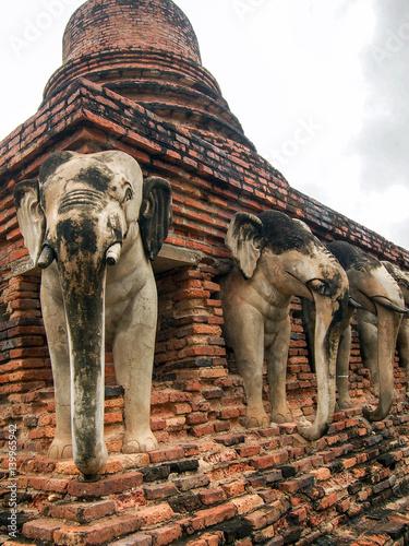 Fotografie, Obraz  Elephant Statues in Ancient Stupa in Sukhothai Thailand
