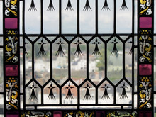 Looking Out Through Stained Glass Window In Amboise France