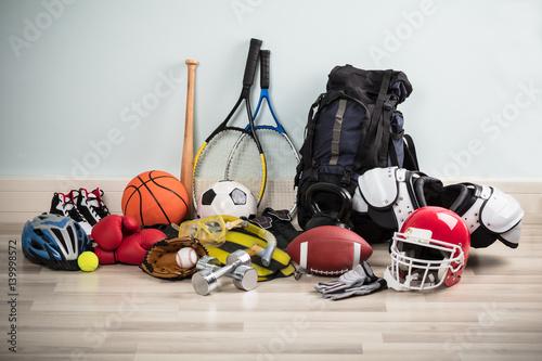 Obrazy Sporty z Piłkami  sport-equipments-on-floor