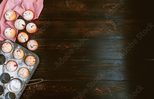 Fotobehang Vissen Muffin in a baking dish on a wooden background