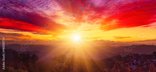 Fototapeta Amazing mountain landscape with colorful vivid sunset on the bright sky, natural outdoor travel background obraz