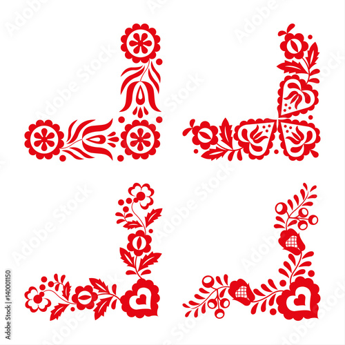 Photo  Set of four traditional folk ornaments, red embroidery isolated on a white backg