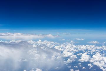 Clouds, sky as seen through window of an aircraft