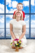 Young beautiful mother with her son and a bouquet of flowers. The child closed his mother's eyes, surprise.Spring concept of family vacation. Women's day.