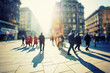 Leinwandbild Motiv Crowd of anonymous people walking on busy city street