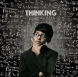Thinking. Genius Little Boy Thinking Wearing Glasses Chalkboard