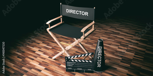 Fototapeta Movie director chair and clapper on wooden background