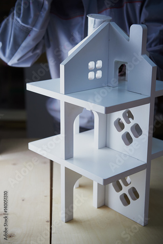 Photo  Painting white Dollhouse in the Studio. MDF