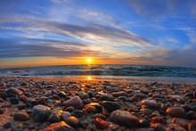 Beautiful Sea Sunset And Sun Glare On Wet Pebbles
