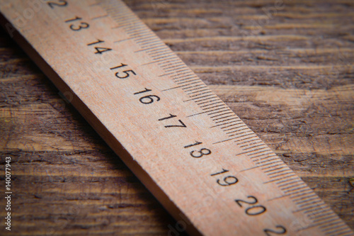 Fotografia, Obraz wooden ruler on wooden background