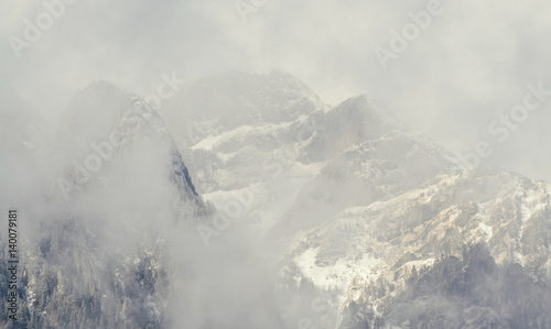 Fototapety, obrazy: Romanian carpathians mountain range with pine forest and fog, winter time with snow