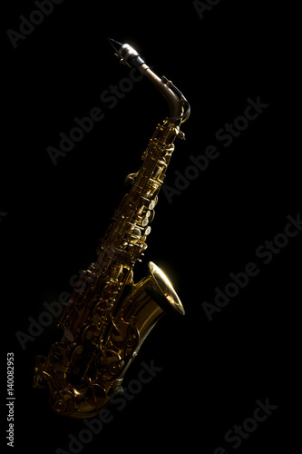 low key vintage alto saxophone and light in the dark background Wallpaper Mural