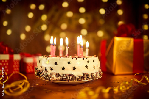 Happy Birthday Cake With Candles On The Background Of Garlands And Letters