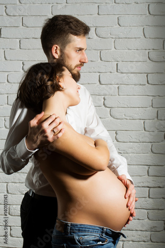 a04fa10d7a4 bearded man and pretty pregnant woman with naked round belly - Buy ...