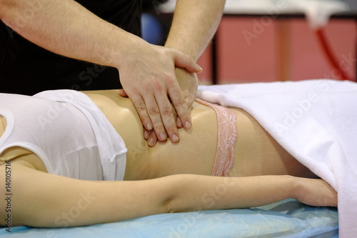 Deurstickers Akt Professional body massage in the salon