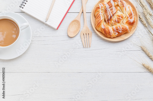 Fotografia, Obraz  Danish pastries, coffee and note book on white wooden table