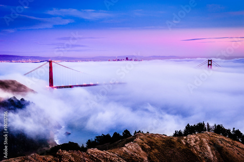 Golden Gate Bridge at dawn surrounded by fog from Marin Headlands in San Francis Plakát