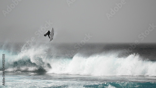 Surfer jumping on a wave Wallpaper Mural