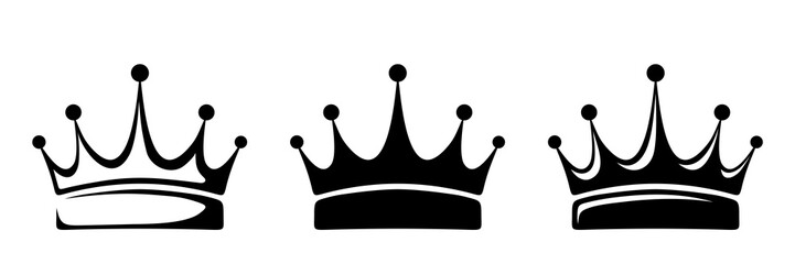 Set of three vector black silhouettes of crowns isolated on a white background.