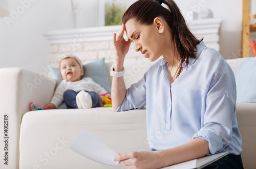 Fotomural Hardworking young mother suffering from exhaustion