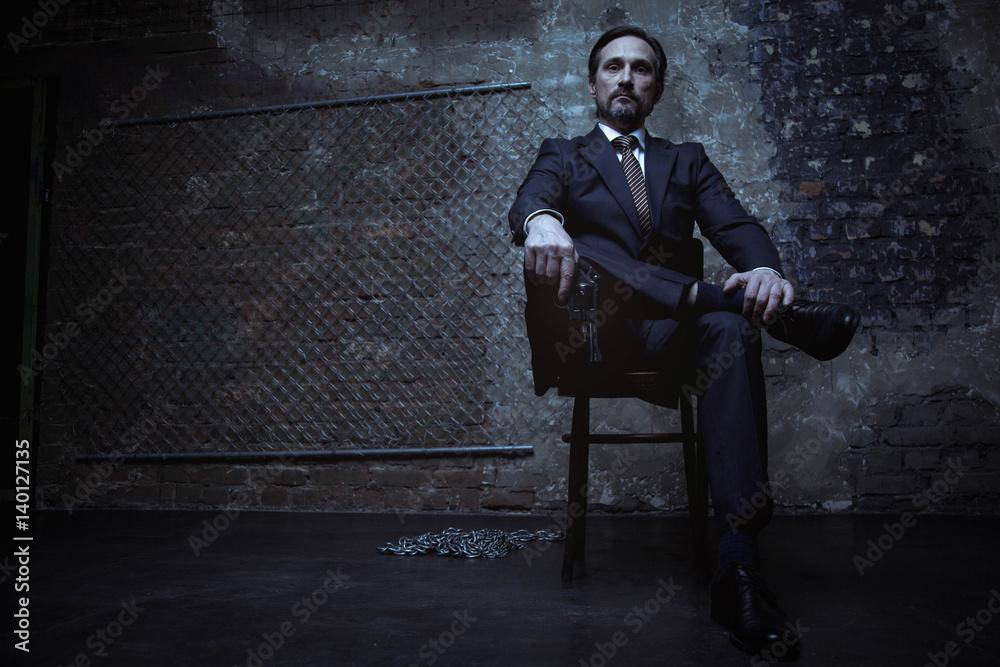 Fototapeta Powerful world class criminal sitting on his throne