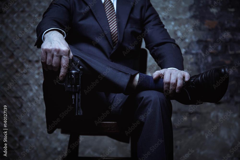 Fototapeta Big mafia boss posing with his weapon