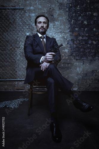 Obraz na plátně  Mafia boss looking classy and dangerous