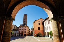 Piazza Risorgimento, Main Square Of Alba (Piedmont, Italy) Seen Through The Colonnade Of Saint Lawrence Cathedral