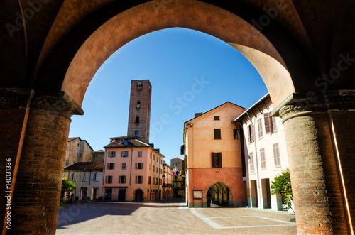 Piazza Risorgimento, main square of Alba (Piedmont, Italy) seen through the colo Wallpaper Mural