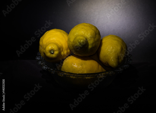 Fotografie, Obraz  Still life lemons isolated on a dark black background