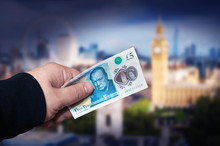 Money English Five Pound Note In A Man's Hand Concept.