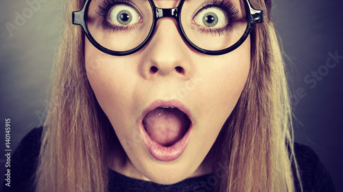 Fotografia, Obraz  Closeup woman shocked face with eyeglasses
