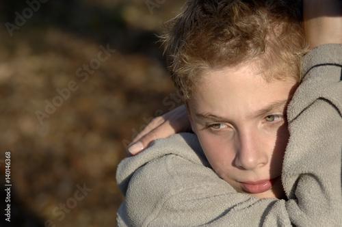Fotografie, Obraz  Boy resting head on his arm
