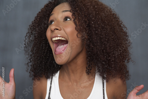 Fototapety, obrazy: Mixed race woman in front of a blackboard, close-up