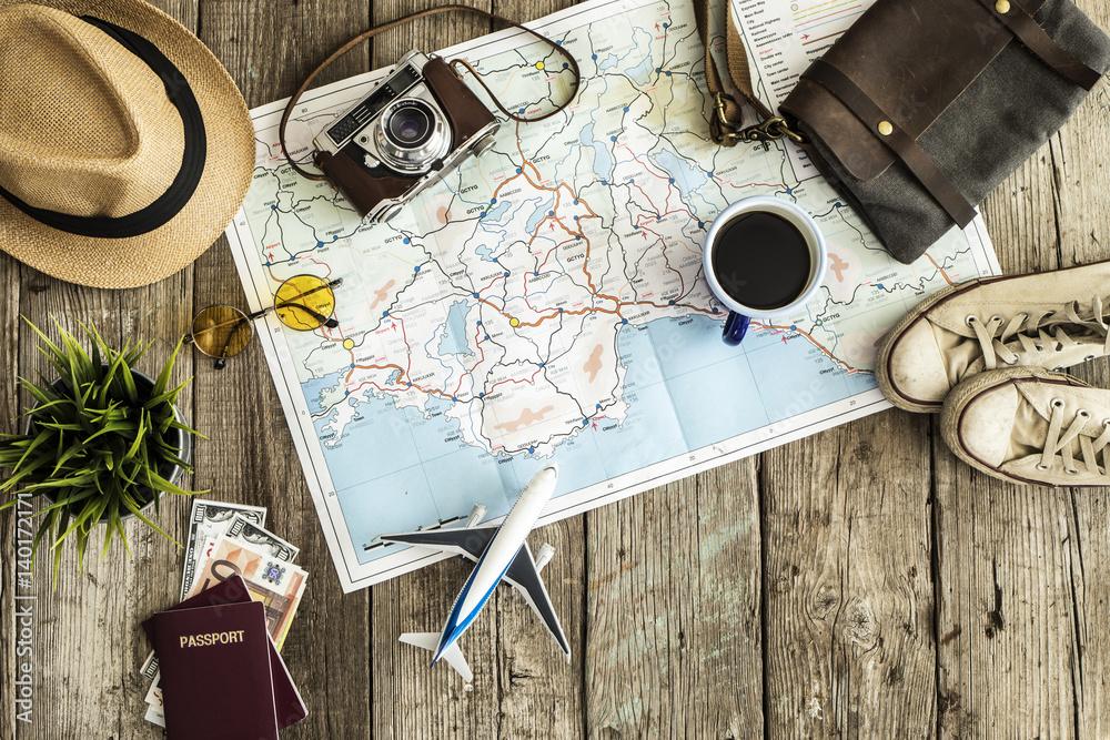 Fototapeta Travel concept on wooden table