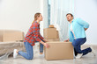 Man suffering from ache while moving box in room