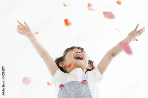 Girl Playing With Flower Petals