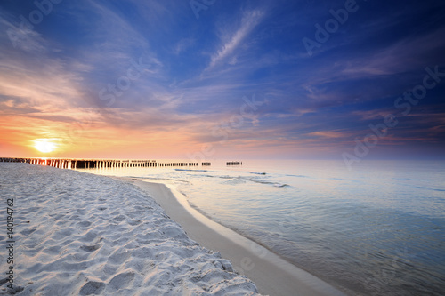 Poster de jardin Taupe Sunset on the beach on the Baltic Sea