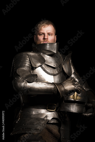 Photo  Knight in armour after battle on the black background