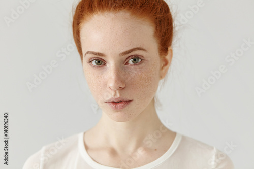 Close up studio shot of beautiful charming redhead European model with healthy f Tableau sur Toile