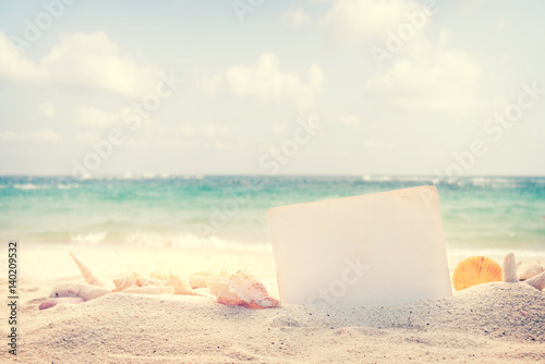 Vintage summer beach background with sand, shells and empty paper for your message design Tablou Canvas