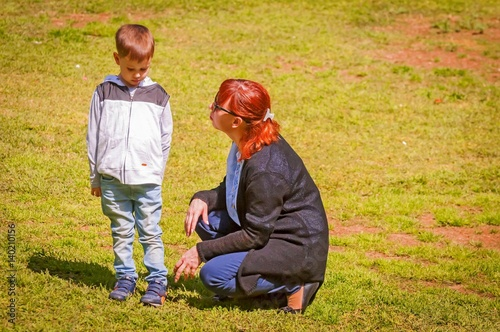 Fényképezés  Young mother comforting her upset little child outside stock image