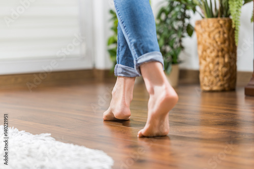 Warm floor - the concept of floor heating and wooden panels.