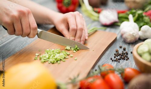 Staande foto Groenten Slicing, chopping and peeling the vegetables cook.