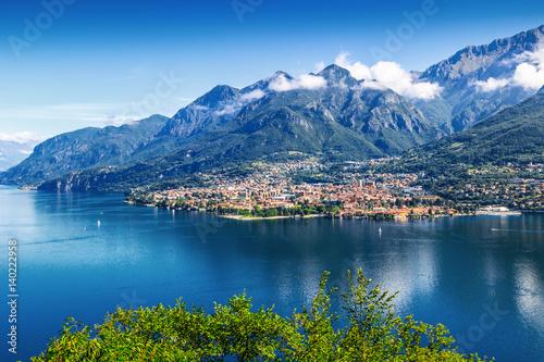View of small town at the foot of Alpine mountain, Mandello del Lario, Como lake Italy Fototapeta