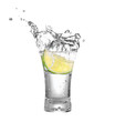 vodka or tequila in glass with lime slice